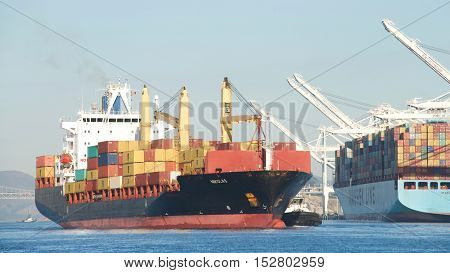 Oakland CA - September 26 2016: Cargo Ship NIKOLAS entering the Port of Oakland. The cargo volume at the Port of Oakland makes it the fifth busiest container port in the United States.