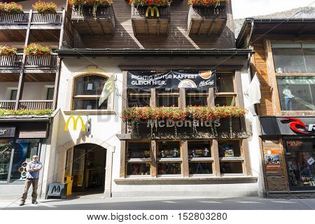 MCDONALD IN ZERMATT, SWITZERLAND - Sep 12: The blend in decorated Mcdonald in Zermatt, Switzerland on Sep 12, 2016. Matching with surrounding building decoration, Mcdonald give an image to their customer that they are a part of the town.