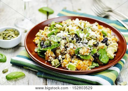 pumpkin quinoa black beans spinach Feta salad with pumpkin seeds