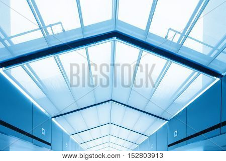 The interior of the modern building with clear glass ceilings.