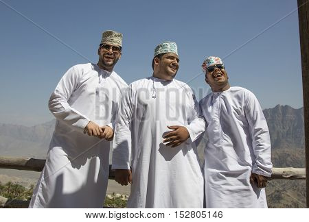 Wakan village Oman October 15th 2016: Three omani guys in mountains