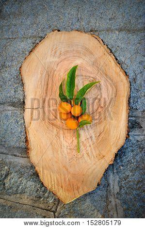 kumquat flat lay, top view on the wooden board