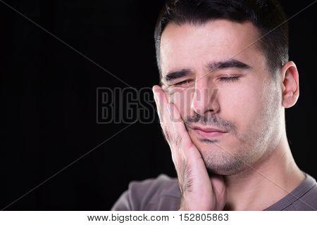 Closeup portrait young man with sensitive toothache crown problem