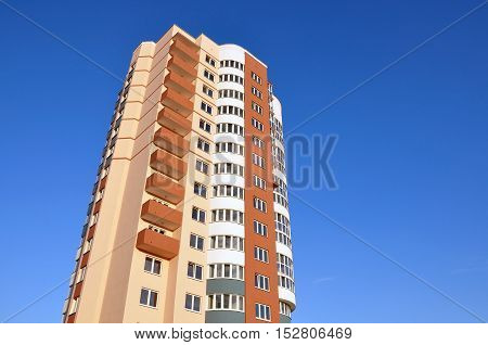 Grodno, Belarus - August 2, 2016: A modern multistory apartment house with round balconies in Grodno district against the blue sky. Lookup. Place for text.