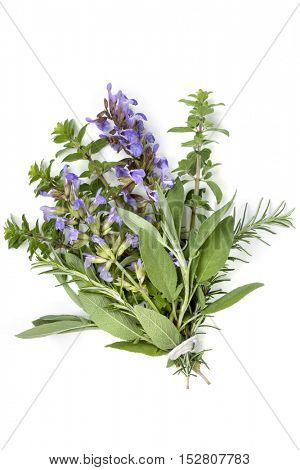 Bunch of fresh herbs, or bouquet garni, isolated on white.  Tied with string.  Includes flowering sage, rosemary and thyme.