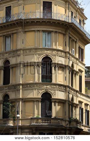 Old orange corner house in the center of Rome Italy