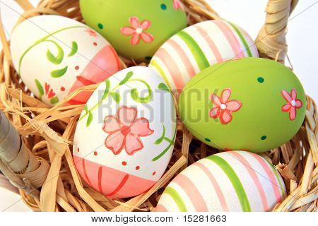 Hand painted easter eggs. Shallow depth of field, focus on the two main front eggs.