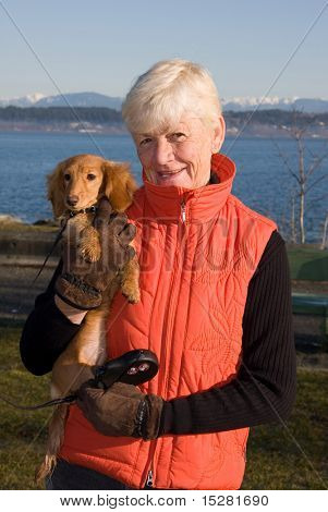 Grandma and her dachshund puppy