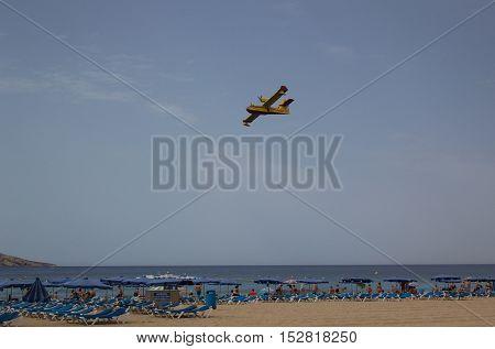 BENIDORM SPANE - 28 June 2016: Hydroplane flying over beach
