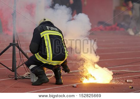 Firefighter Putting Down Football Fans' Torches Fire