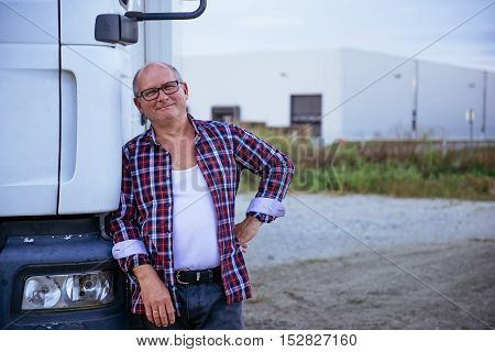 Posing Next To His Truck