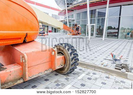 Zrenjanin Vojvodina Serbia - September 25 2015: Cherry picker is moving over tiled ground at construction site.