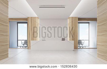 Close Up Of Reception Desk In Light Wood Corridor