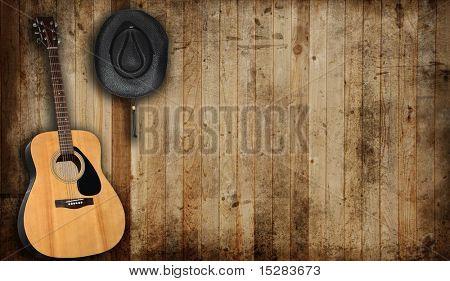 Sombrero de vaquero y Guitarra trasfondo un viejo granero.