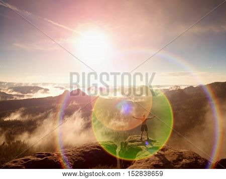 Flare. Lens Defect, Reflections. Climber In Pants With Raised Arms. Body Naked Man