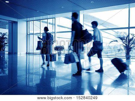 Passengers at the Shanghai airport, blue tones.