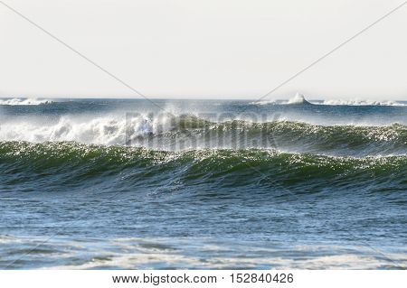 Swell pushing into Buzzards Bay in Westport Massachusetts producing good-sized waves