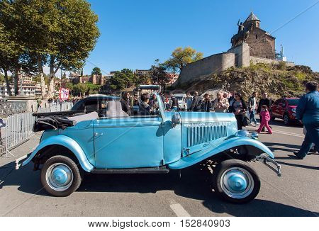 TBILISI, GEORGIA - OCT 16, 2016: Blue retro car on the show of vintage auto exhibition during the Tbilisoba on October 16, 2016. Tbilisoba is traditional festival in Tbilisi from 1979