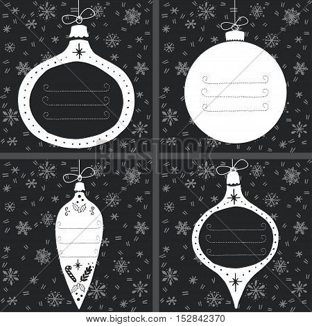 Set of four vintage Christmas baubles on chalkboard background with snowflakes and place for your text. Hand drawn gift tags in shape of Xmas ball.