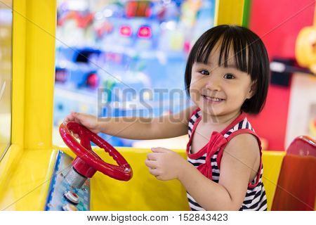 Happy Asian Chinese Little Girl Driving Toy Bus