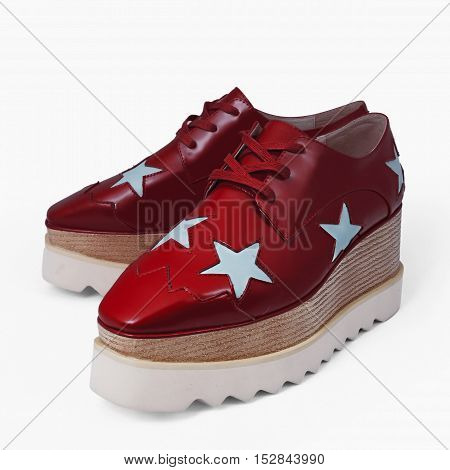 fashion female red shoes in white background
