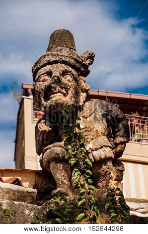 This is famous grotesque statues with human faces that decorate garden and wall of the Villa Palagonia or The Villa of Monsters near Palermo Sicily Italy.