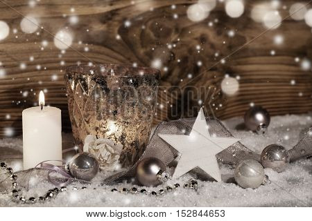Wintery Christmas still life in front of a wooden wall and bokeh