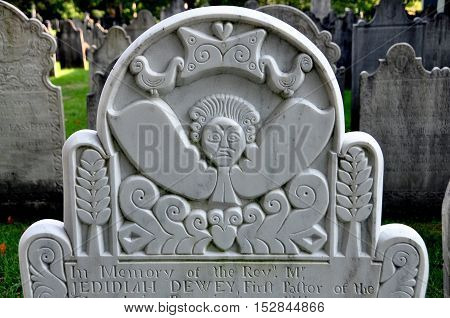Bennington Vermont - September 19 2014: 18th century colonial gravestone with carved angel face in the 1806 Congregational Church burial ground