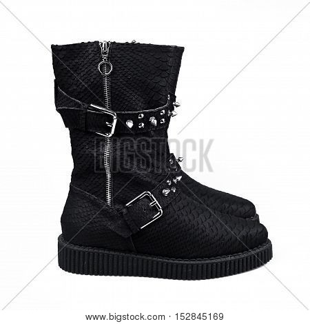 female winter black boots over white background