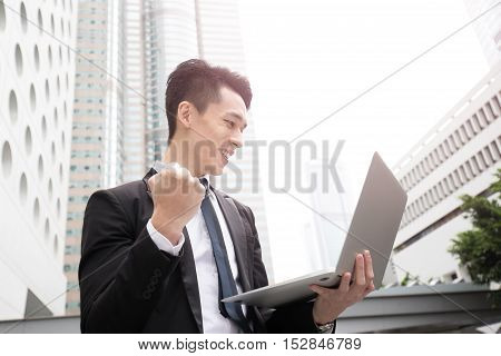 businessman happy use computer in honkong asian