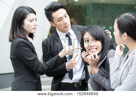 businesspeople bullying in office and someone unhappy,asian