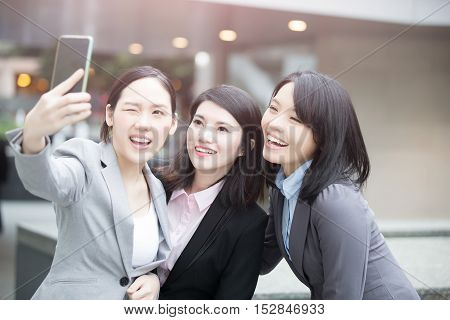businesswoman selfie and smile happily in hongkong