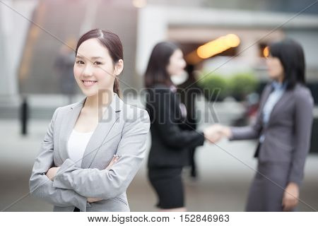 businesswoman smiles happily at you in hongkong