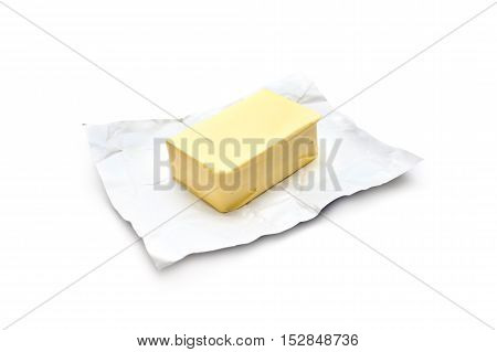 Piece of butter on a white background