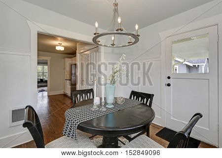 Dining Black Round Table With Four Cushioned Chairs. Dining Room