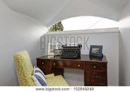 Small Home Office Area With Retro Typing Machine.