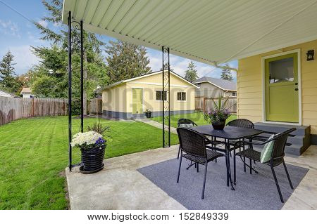 Backyard View With Covered Patio Area .