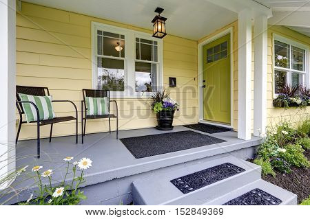 Covered Porch With Stairs. Small American Yellow House Exterior