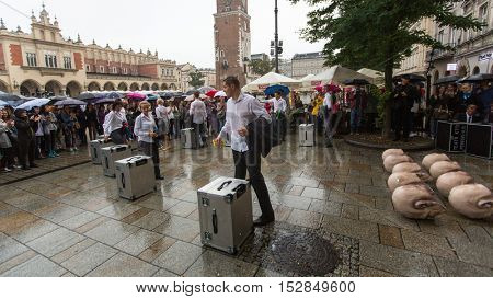 KRAKOW, POLAND - SEP 17, 2016: Participants of Krakow Theatre Night festival - KTO Teatre (Peregrinus) in Main Market Square. Entry to all shows of Theatre Night is free.