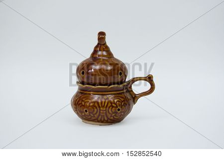 Pottery On A White Background, A Clay Lamp For Incense