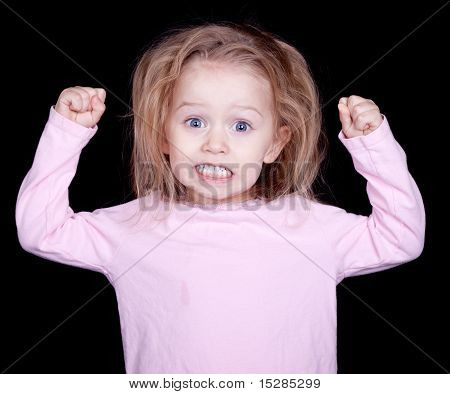 A kid throwing her fists up in anger. She is acting out and misbehaving. poster