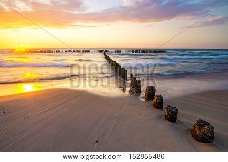 sunset over the sea beach,Baltic Sea,Poland,waves crashing on breakwater