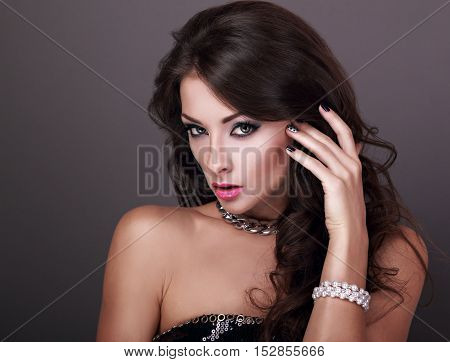 Beautiful Bright Evening Makeup Woman With Long Curly Hairstyle Looking Sexy In Pearl Bangle And Fas