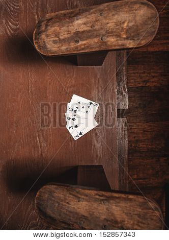 playing cards on the table of shoe shiner, top view