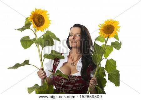 woman in a dirndl with sunflowers on white