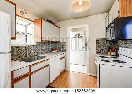 Old Style Kitchen Interior With Hardwood Floor And White Appliances