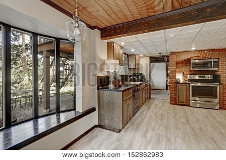 Kitchen Area With Red Brick Wall And Built In Appliances