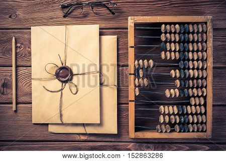 Vintage abacus envelopes and letters on wooden table