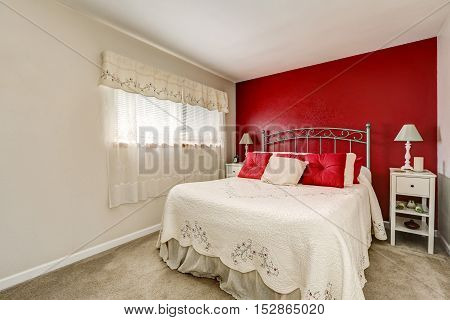 Bright Woman's Bedroom With Red Contrast Wall