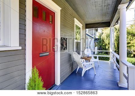 Entrance Porch With White Columns, Blue Wooden Floor, Red  Door